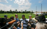 Broncos wide receiver Rod Smith (center) talks with reporters about this upcoming season and the...