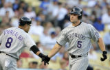 CAJH101 - Colorado Rockies' Matt Holliday, right, is greeted by his teammate Yorvit Torrealba...