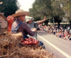 Lakewood on Parade three people on hay wagon