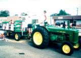 Lakewood on Parade John Deere tractor and hay wagon