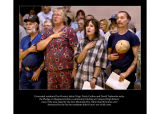 Evacuated residents recite the Pledge of Allegiance before a briefing.